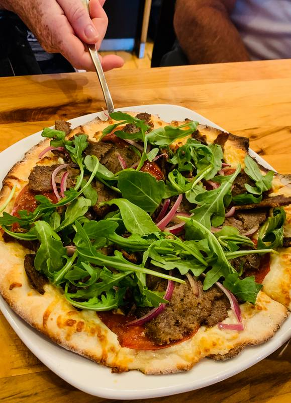 Donair Pizza being served at Atomica